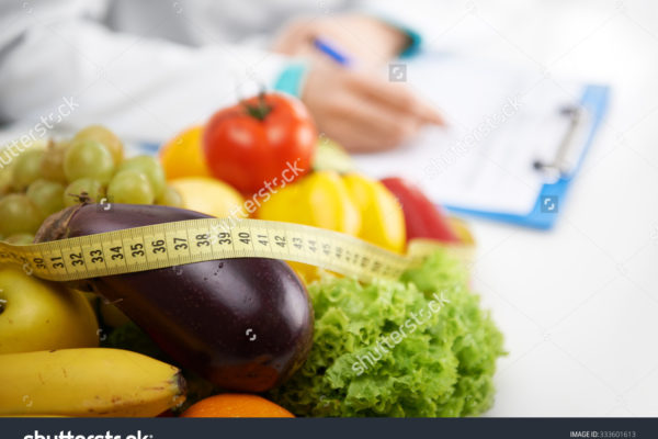 stock-photo-healthy-nutrition-concept-close-up-of-fresh-vegetables-and-fruits-with-measuring-tape-lying-on-333601613